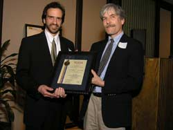 Jeremy Semrau smiling, receiving award