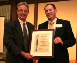 Robert Frosch smiling, receiving award